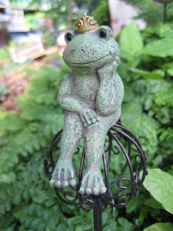 Frog prince on a garden stake