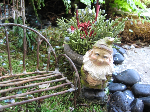 Gnome at home with his holiday greens