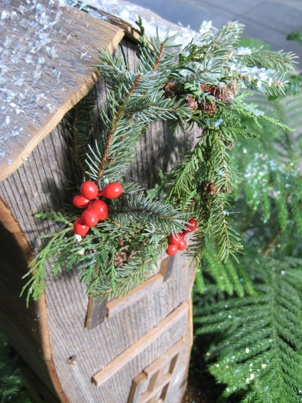Wreath hanging on a crooked wood house