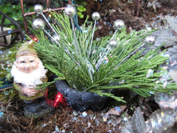 Gnome with decorated evergreens