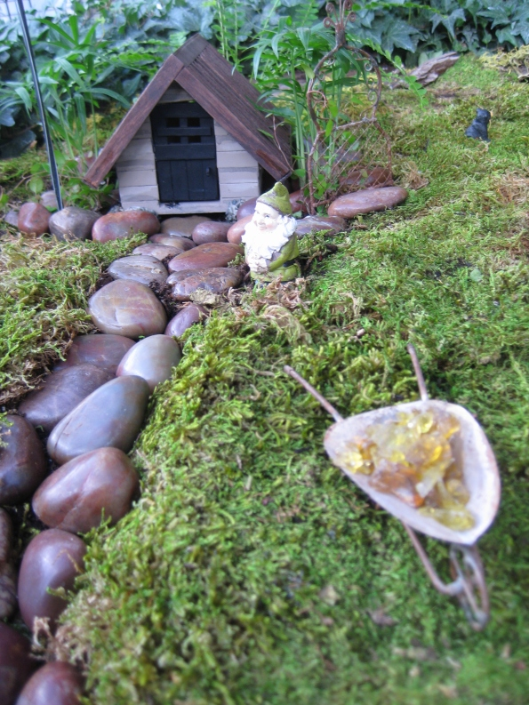 Cottage in the woods with a wheelbarrow full of gold